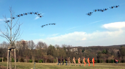 Markerless Outdoor Human Motion Capture Using Multiple Autonomous Micro Aerial Vehicles